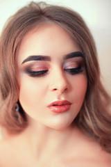 Beautiful model girl with Fashion Luxury Makeup, long eyelashes, perfect skin facial make-up. Beauty Brunette model woman holiday make up close up. Eyelash extensions, false eyelashes. Beauty Woman.