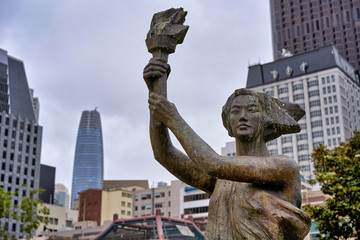 SAN FRANCISCO, CALIFORNIA, USA - MAY 14, 2018 - City statue of a woman with a torch