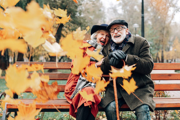 Positive delighted mature couple enjoying the moment