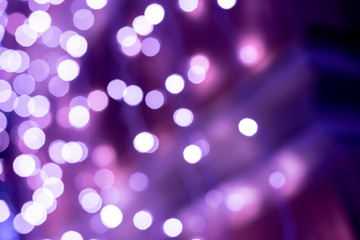 Purple bokeh blurred lights background. Violet garlands decoration for the new year celebration.