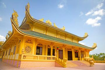 Golden Buddhist temple, Phu My, Vietnam.