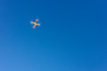 White drone flying over a blue sky