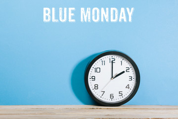 Blue Monday words on blue colored background with clock