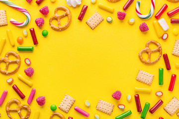 Sweets flat lay on yellow background