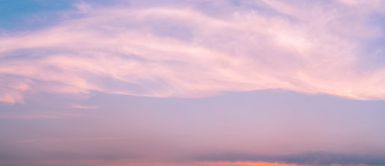 Dramatic pink sky and clouds abstract background. Art picture of pink clouds texture. Beautiful sunset sky. Sunset abstract background. Pastel color sky in the evening. Calm and relax life. Happy love