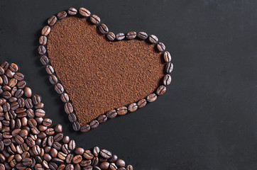 Ground coffee and beans in the shape of a heart