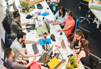 Young co-workers team talking during startup - Focus on left man with headphones