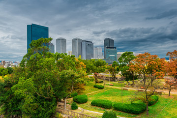 beautiful landscape of Osaka city with modern buildings and park, Japan, daytime, autumn