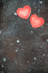 Valentine's Day background with red wooden hearts