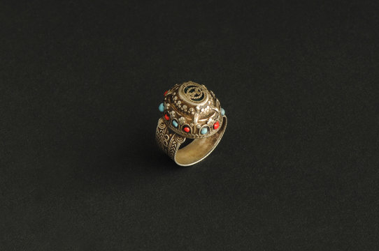 ancient antique ring with stones on black background. Middle-Asian vintage jewelry