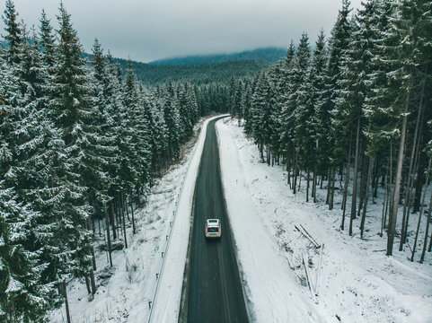 beautiful view of snowed freeway in mountains road trip