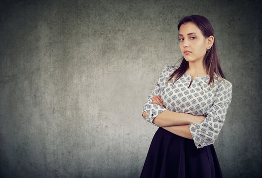 Arrogant young woman with arms crossed