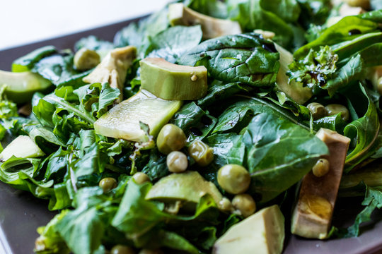 Avocado Salad with Green Peas and Rocket Leaves in Rectangular Plate / Arugula or Rucola Leaves.