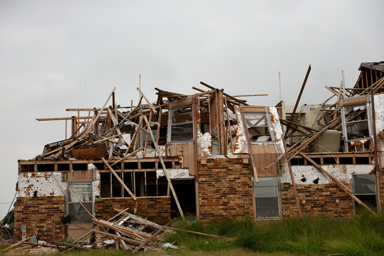 Hurricane Harvey major wind damage and destruction to brick and wood apartment unit complex.