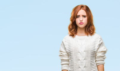 Young beautiful woman over isolated background wearing winter sweater depressed and worry for distress, crying angry and afraid. Sad expression.