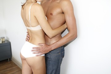 Midsection of couple embracing
