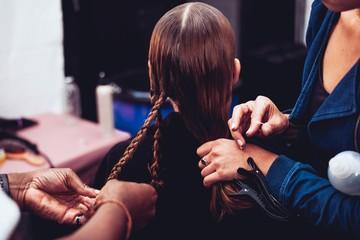 Hairdressers doing hair of customer