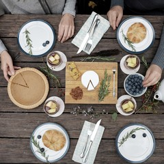 Overhead view of women having breakfast served on table