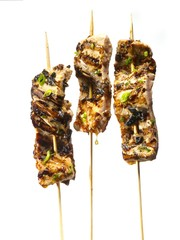 Tuna skewers isolated against white background
