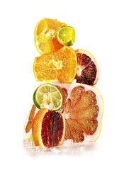 Varieties of citrus fruits against white background
