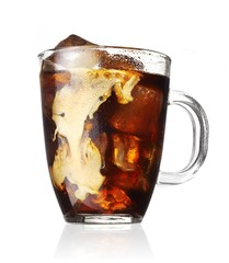 Rum and coke in glass against white background