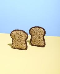 String bread slices over cream color background