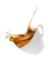 Cup of tea splashed against white background