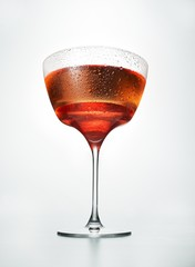Red wine served against white background