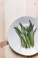 Overhead view of asparagus served on plate