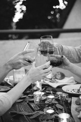 Close up of friends toasting wine glasses