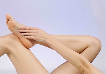 Close up of woman touching her leg