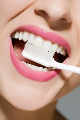 Close up of woman brushing her teeth