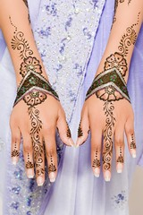 Woman wearing henna tattoos on her hands