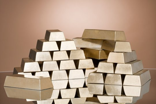 Close up of stack of gold bars