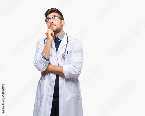 Young Handsome Doctor Man Over Isolated Background With Hand On Chin