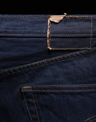 Close up of torn jeans