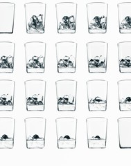 Glasses with ice cubes against white background