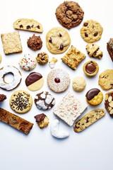 Varieties of cookies on white background