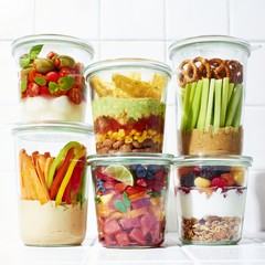 Varieties of fruits and vegetables in airtight jars