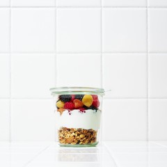 Airtight jar with food  against white background