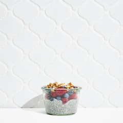 Fruits with chia seed in bowl against white background