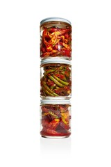 Stack of jars with pickled vegetables isolated against white background