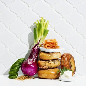 Donuts with vegetables and meat against white background