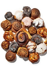 Overhead view of varieties of pastries on white background