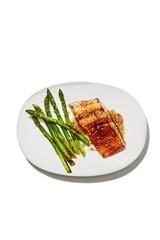 Grilled salmon and asparagus served on plate