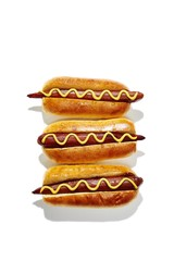 Stack of chili dog isolated against white background