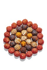 Varieties energy balls isolated against white background