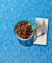 Overhead view of salad served in bowl over blue background