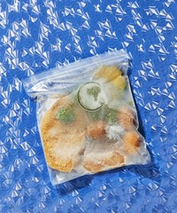 Freeze food in zipper storage bag over blue background