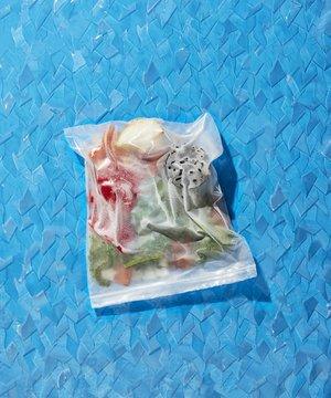 Freeze food in zipper storage bag over blue background
